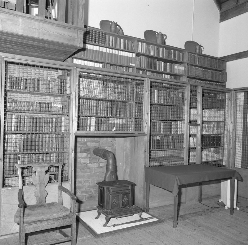 Interior, detail of studio bookcases and stove