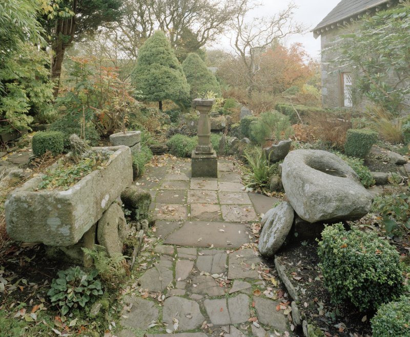 View of garden with sun dial, mill stones and stone troughs