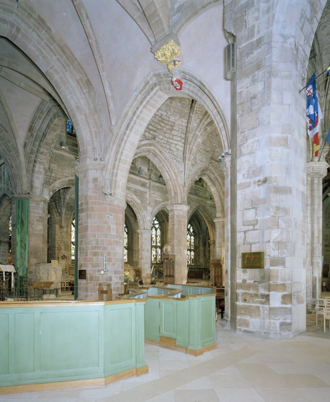 Interior, view from South Transept looking NE showing exposed stone vaulting