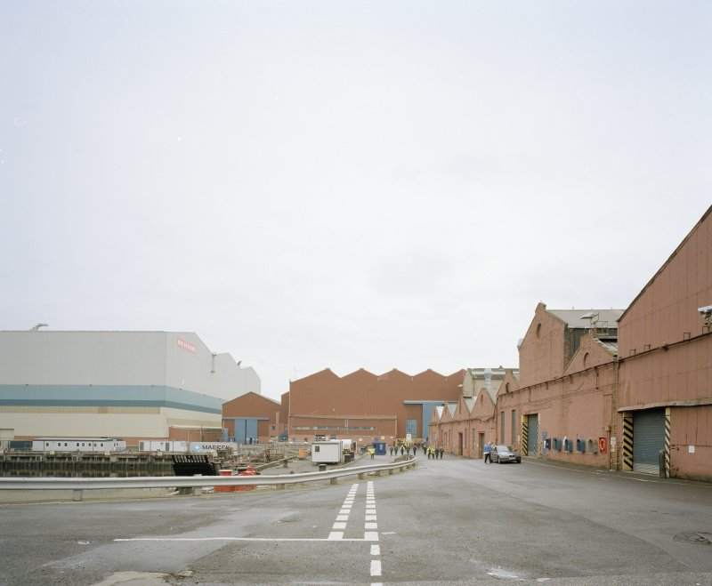 General view from W at S end of fitting-out basin, with former Plumbers' Shops to right, and former engine works beyond, and the new 'Tank Assembly Shop' to the left