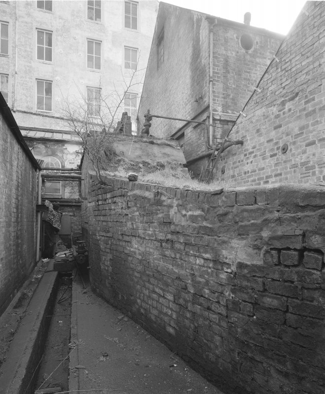View from SW of alley between bolier house and engine room.