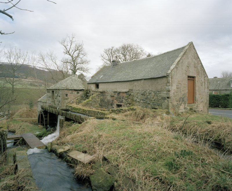 View from SW along W side of mill, showing lade and water wheel