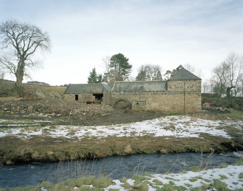 General view of the mill from SSW, with kiln at S end of the range (right), and water wheel to left