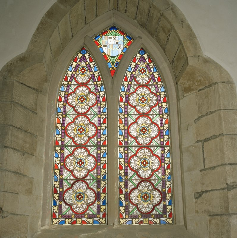 Interior. Detail of 2-light pointed arch stained glass window