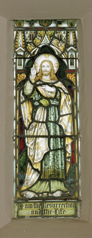 Interior. Detail of stained glass window depicting Christ