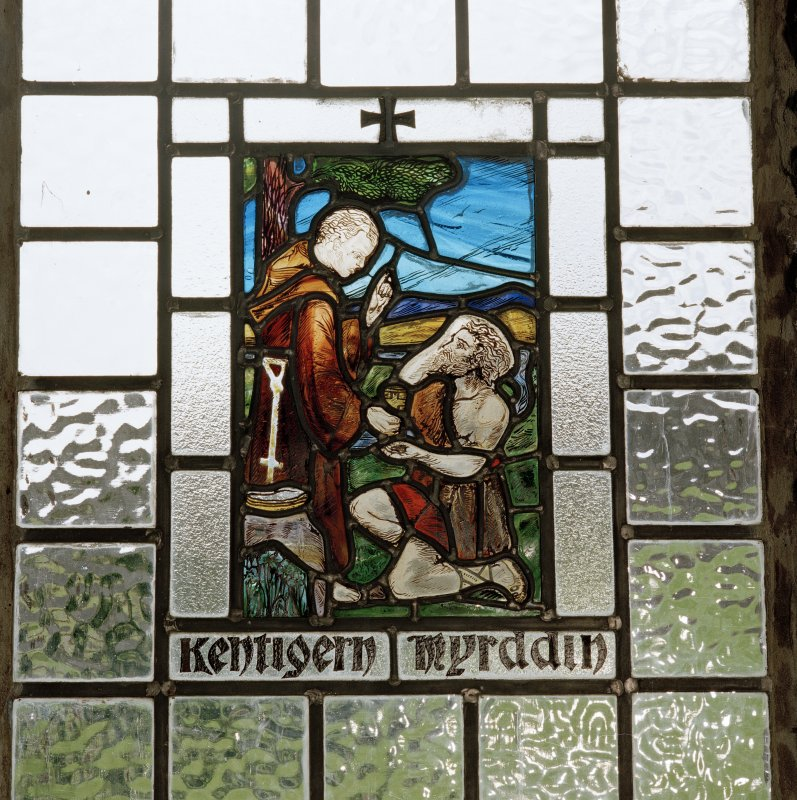 "Interior. Detail of stained glass window with inscription ""Kentigern Myrddin"""