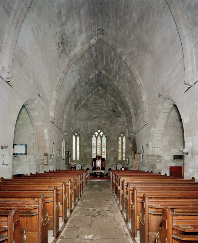 Interior. View of nave from rear showing pews