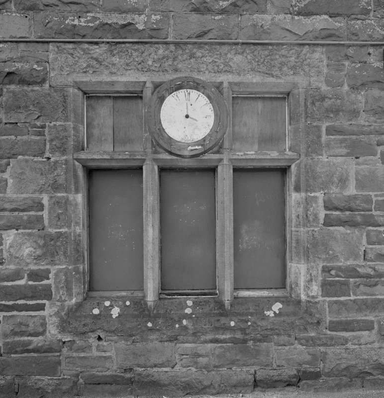 Detail of window and clock in W gable of station building