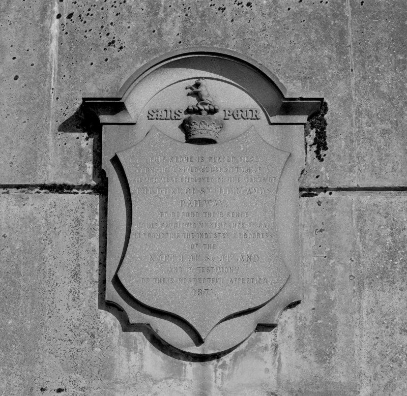 Detail of plaque on SE abutment of road bridge over the railway at N end of platform, commemorating the creation of the Duke of Sutherland's Railway and the completion of the station in 1868