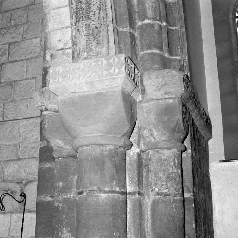 Interior. Detail of S chancel arch pier capitals