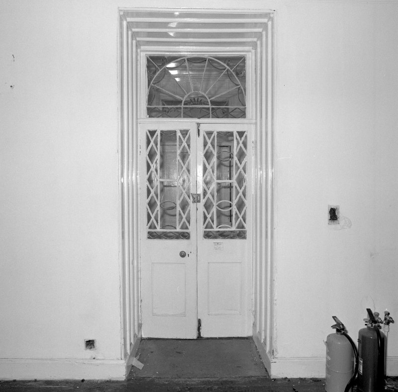 Interior. Detail of hall glazed door and fan light