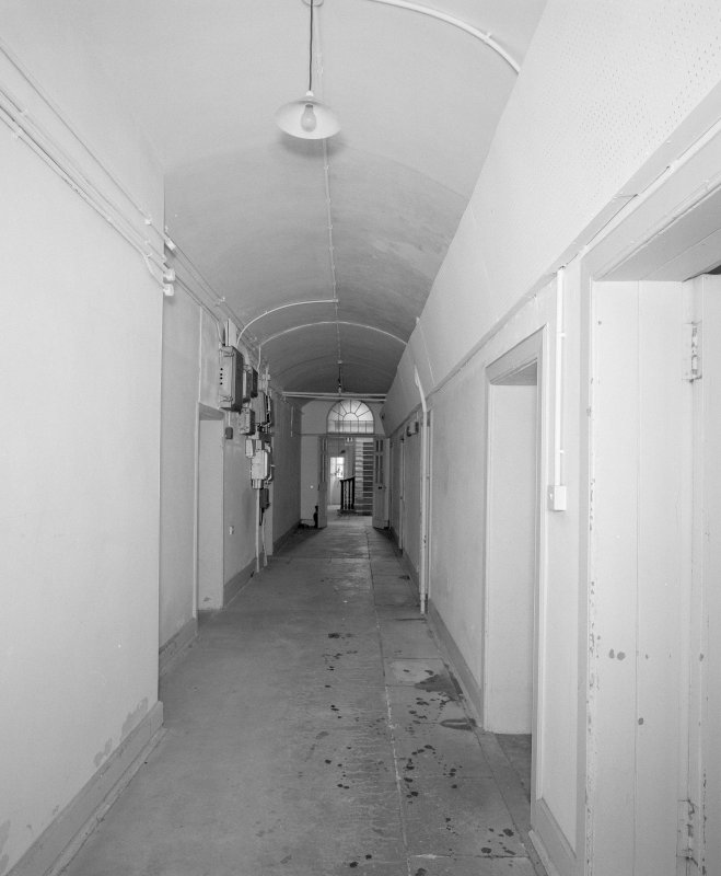 Interior, view of vaulted basement corridor