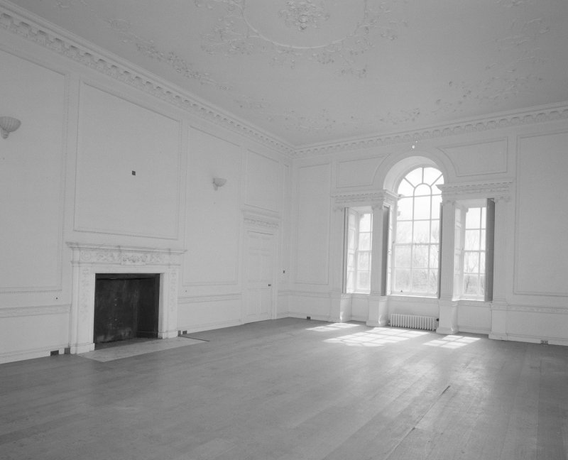 Interior, view of drawing room showing fireplace and venetian window