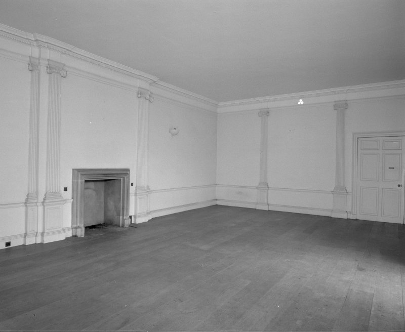 Interior, view of dining room showing fireplace anf ionic pilasters