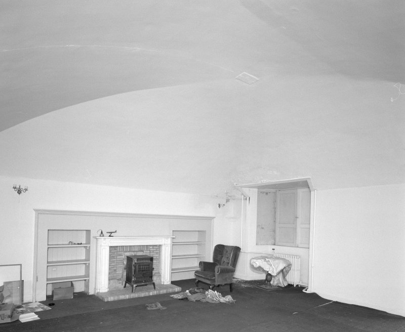 Interior, view of vaulted basement original kitchen now with marble fireplace