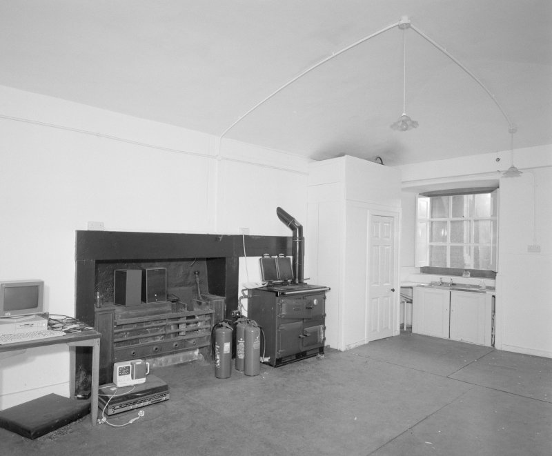 Interior, view of former vaulted scullery with range