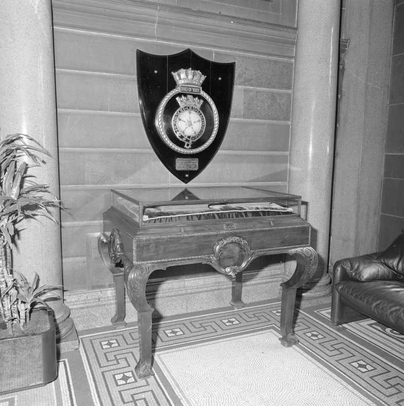 Interior. Ground floor entrance hall detail of roll of honour cabinet