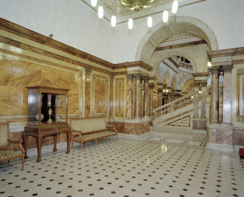"Interior. Second floor "" Queens Square "" or central lobby"