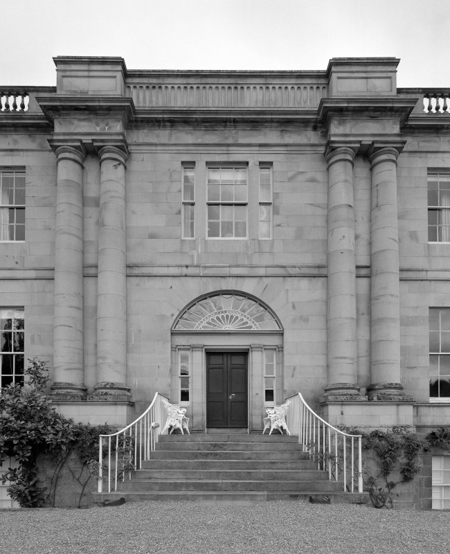 Detail of main S entrance showing paired giant order doric columns, fanlighted tripartite entrance and steps