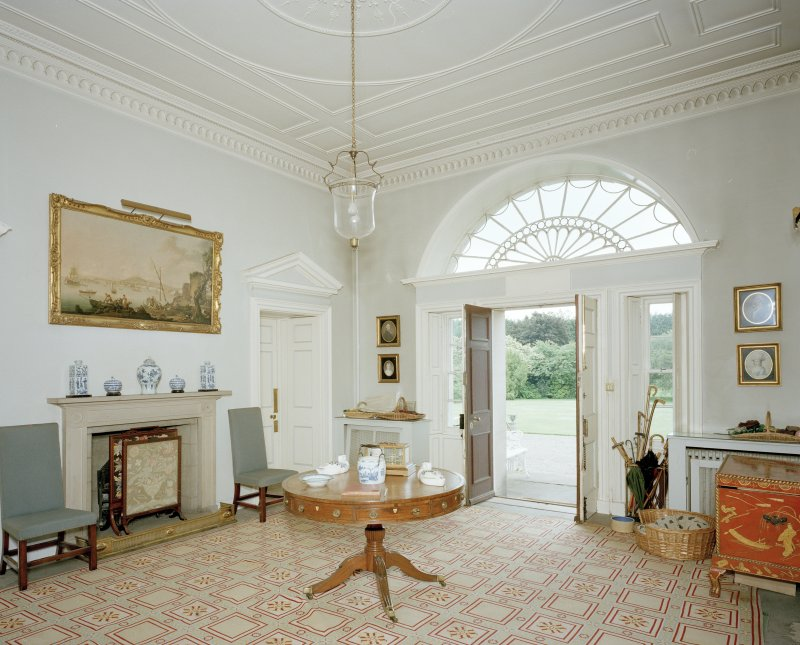 Interior.View of entrance hall from NW showing fireplace and entrance door