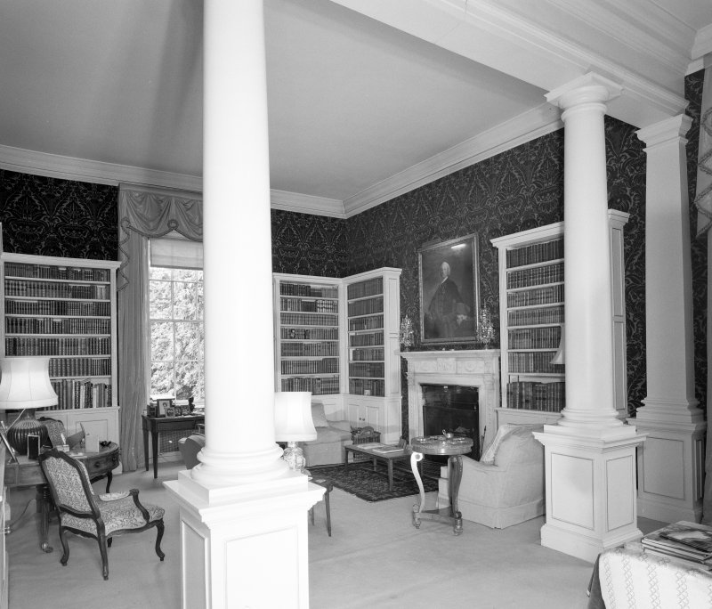 Interior. View of ground floor library from SE through columned screen