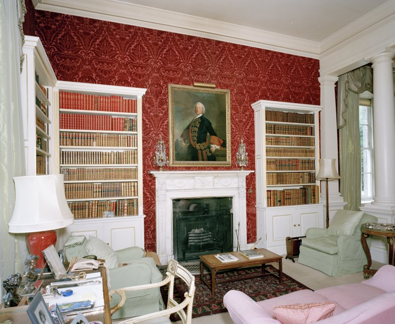 Interior. View of ground floor library from SSW showing fireplace and bookcases