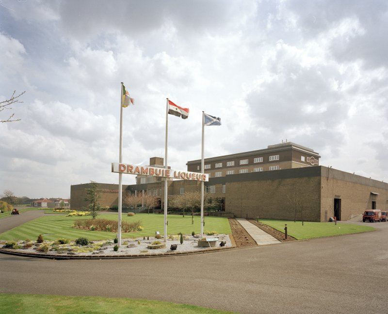 General view from NW within compound of main production and bottling block, with flagpoles in foreground