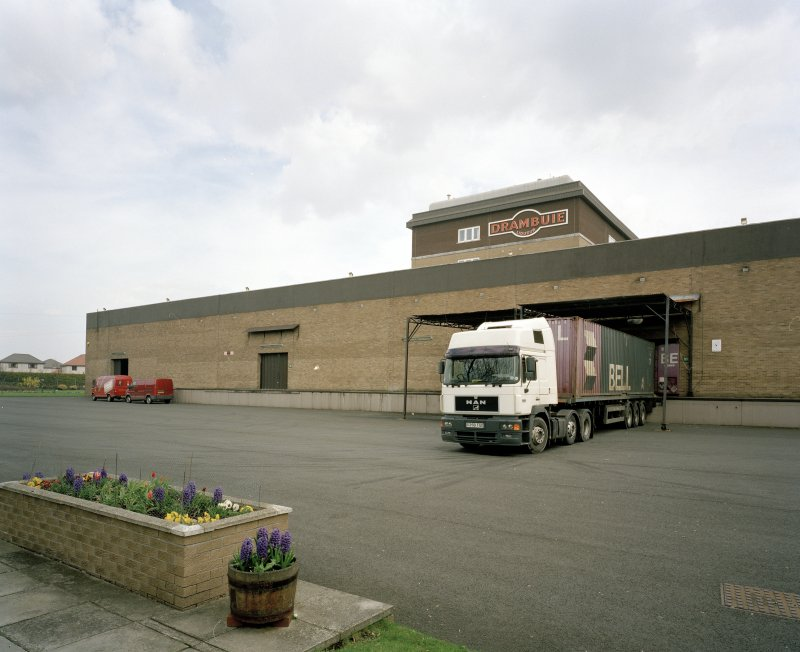 View from SW of W side of main production block, with loading bay and lorry in foreground