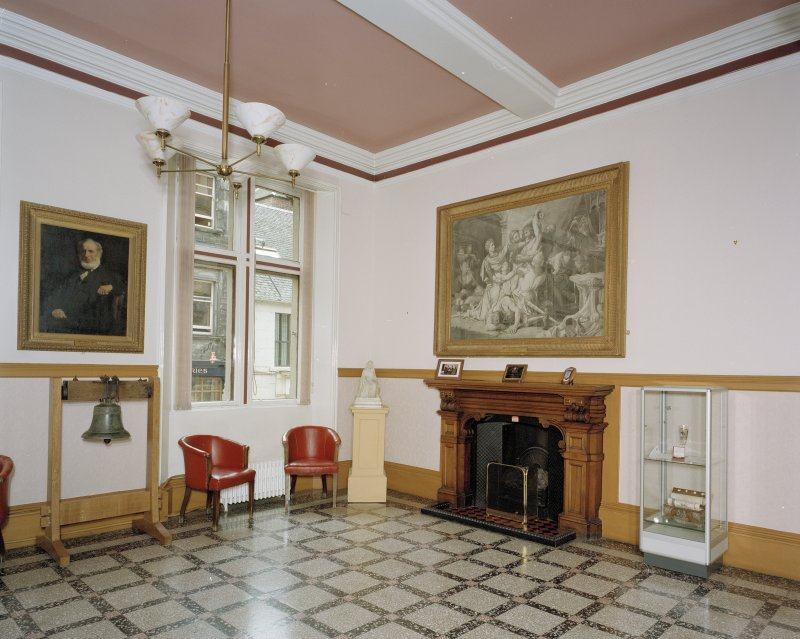 Interior, View of stair hall from North West showing fireplace