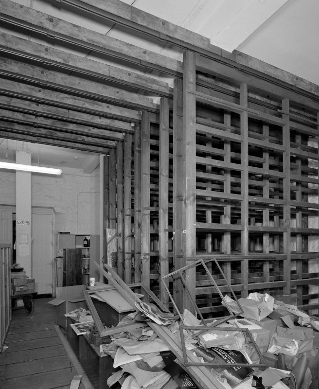 Interior. View of picture store with sliding racks