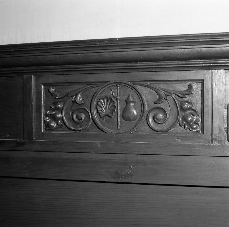 Detail of panelling with pilgrim's staff and shell