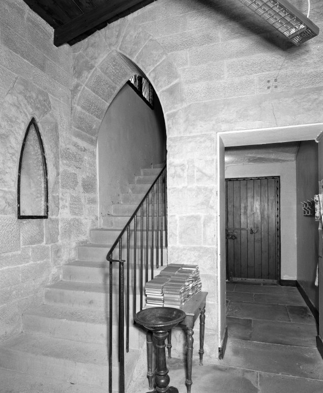 Interior. View of staircase and lobby.