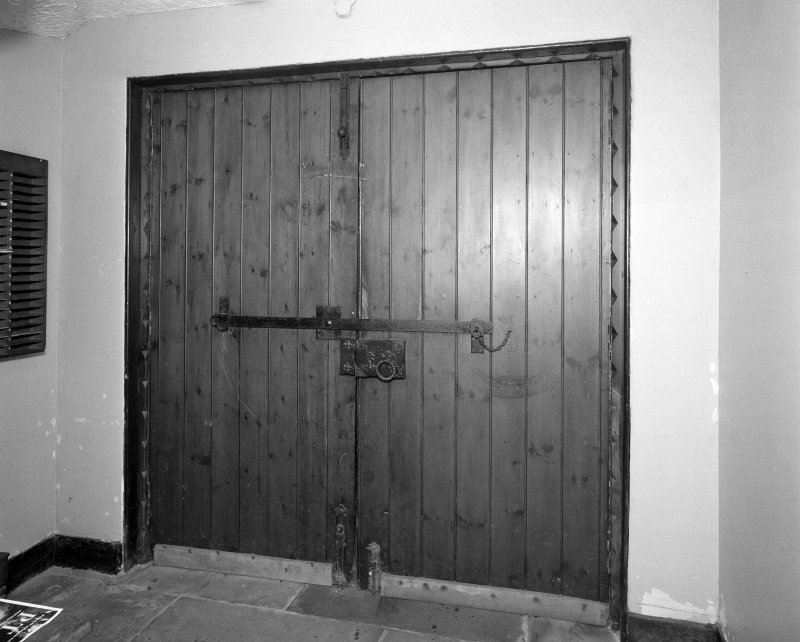 Interior. Detail of front door showing metal bar.