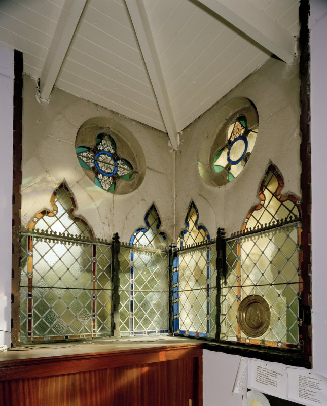Interior. Detail of corner stained glass windows in session room to E.
