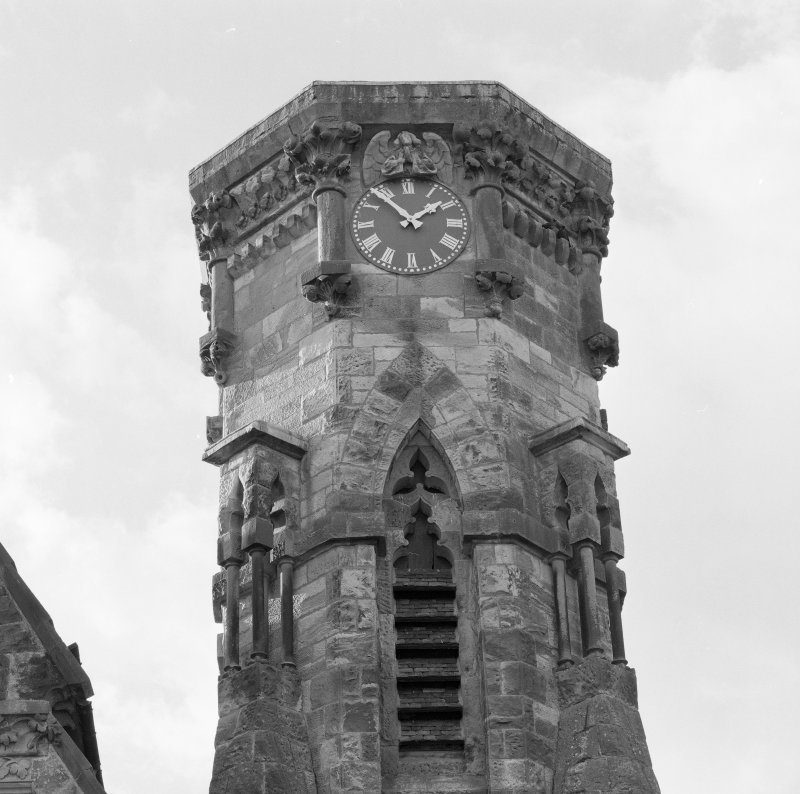 Detail of tower showing clock, elaborate carving and bell chamber louvres.