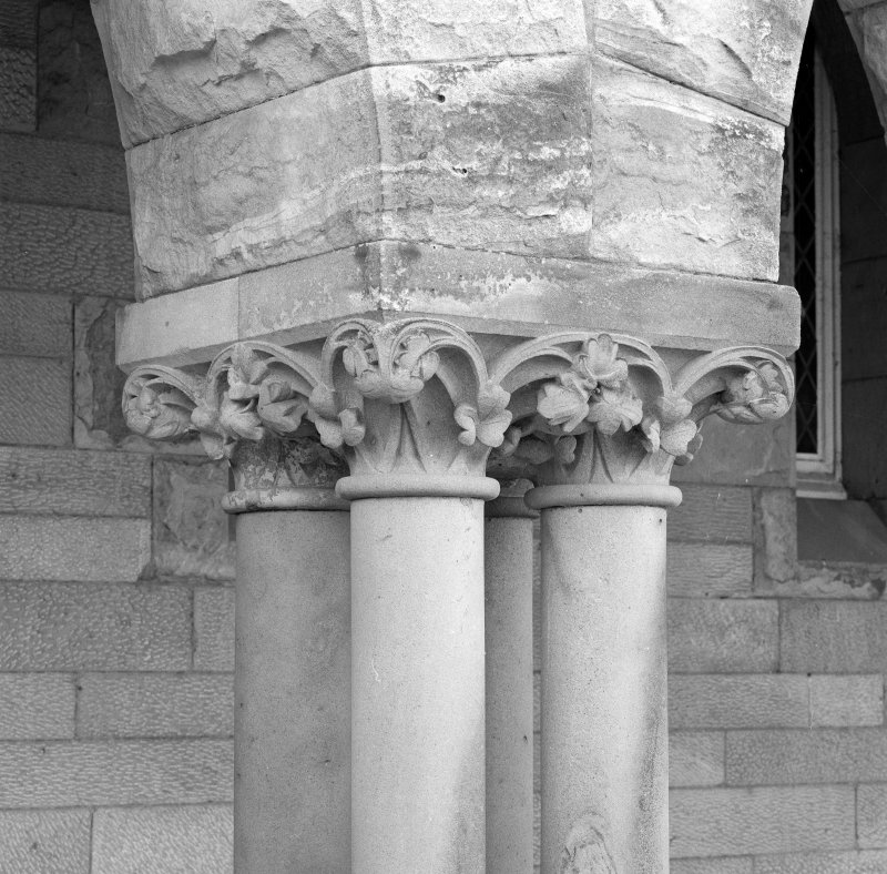 Detail of arcade column foliated capital.