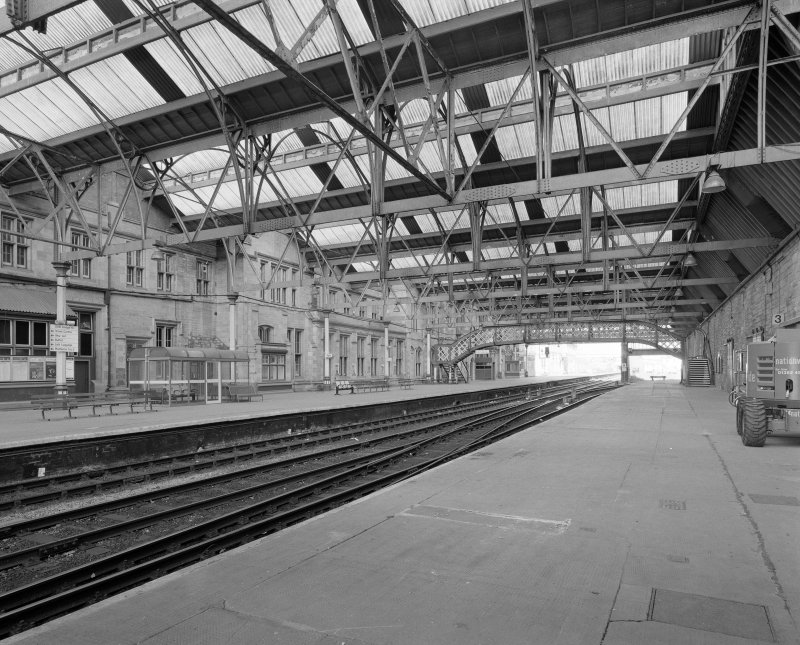 Interior.  View of tracks, platforms, footbridge and ridge and furrow roofs from SSE