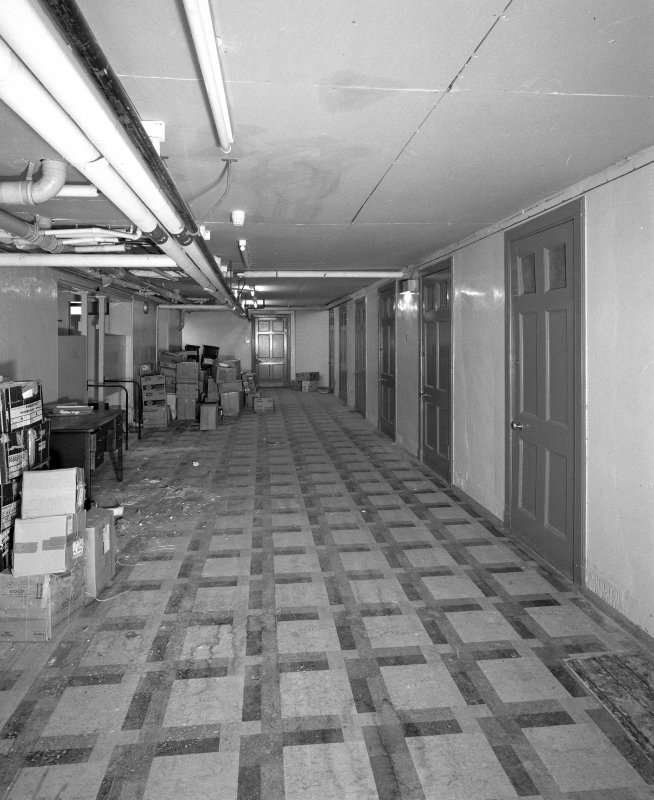 Interior. Basement cells in main block from NE