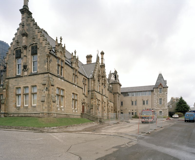 View of south east face of main block with modern extension behind from south south west (after fire)