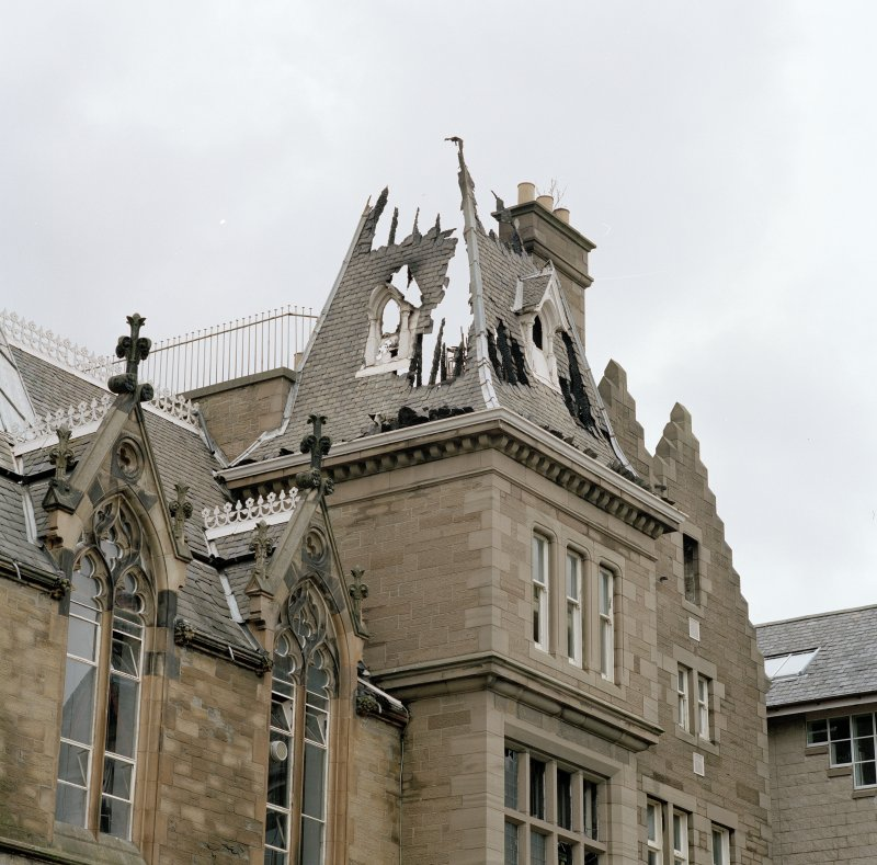 Detail of remains of steeply pitched roof of tower on south east side of main block