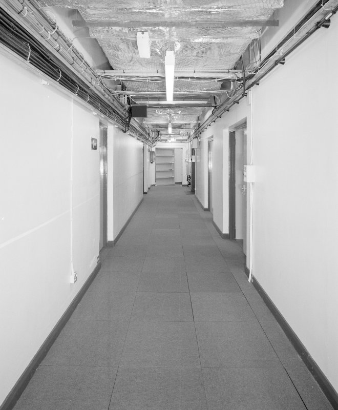 Interior. View of main access corridor from E.