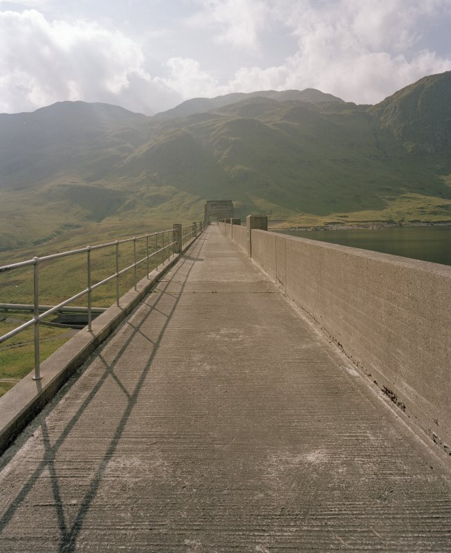 View along top of dam from ENE.