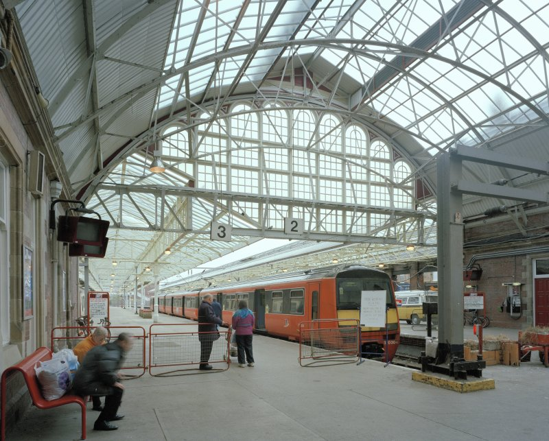 View of platforms from WNW, showing Strathclyde Passenger Transport Executive electric train (in old orange livery)