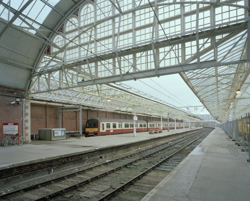 View of platforms from WSW, showing Strathclyde Passenger Transport Executive electric train (in new maroon and cream livery)