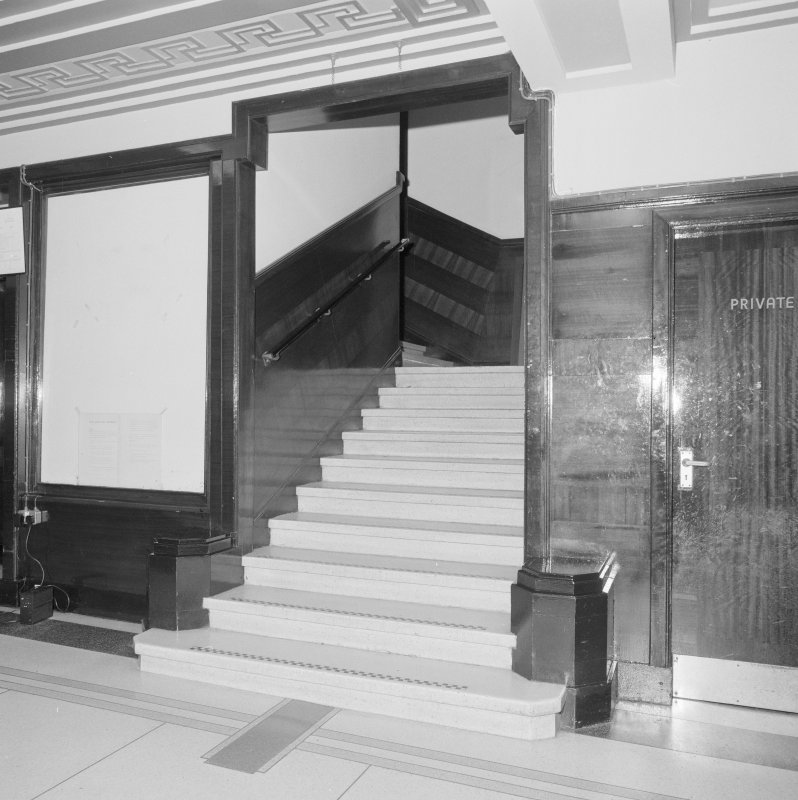 Interior. Detail of foyer and stairs to first floor.