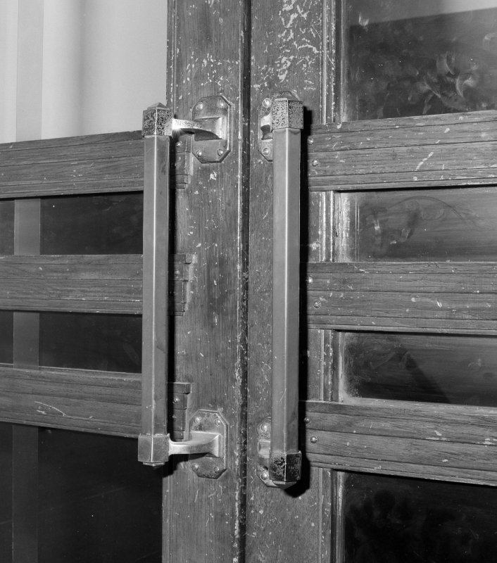 Interior. Detail of first floor lobby doors from foyer.