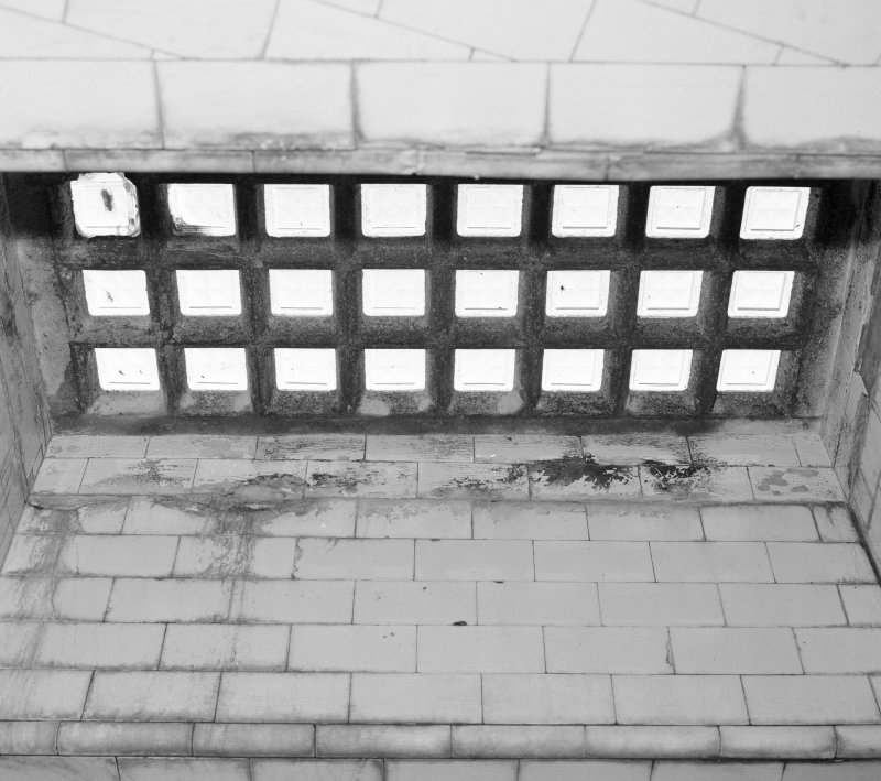 Interior. Detail of one of two 'Lenscrete' panels of reinforced concrete and glass, allowing light from the Union Street pavement above to illuminate the toilets