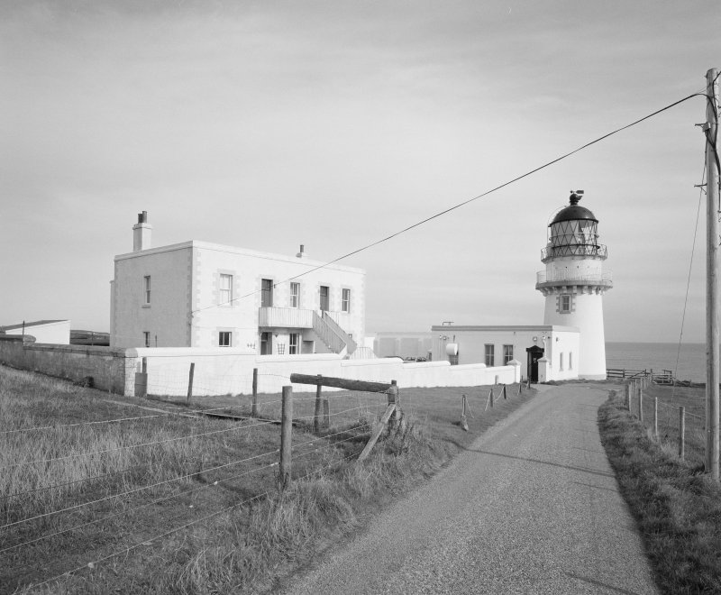 General view of lighthouse, keepers' house and compound from SW