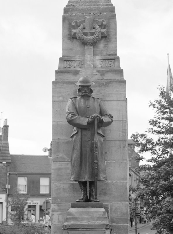Detail from SE showing statue of First World War serviceman and lower shaft of column