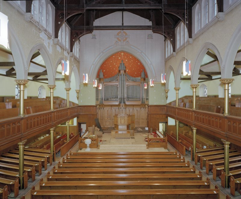 Interior view from gallery to South showing the pulpit and the organ apse.